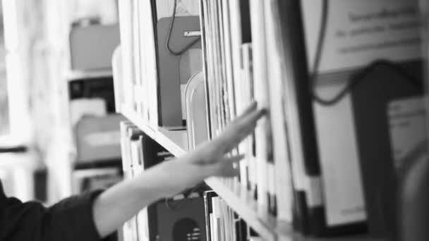 Girl walking between shelves