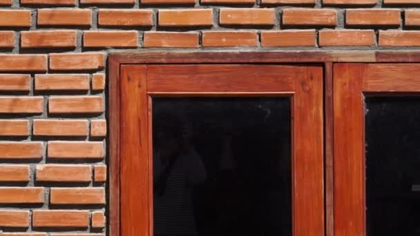 red brick wall texture with wooden frame window