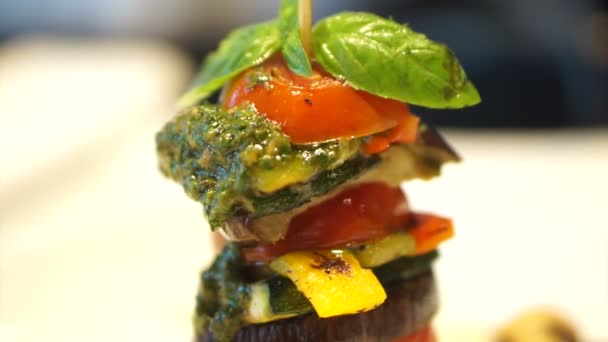 video of healthy vegetarian cuisine, Grill tomatoes and eggplants slice with pesto sauce