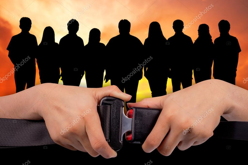Safe teamwork concept,close up two hand use safety belt on teamwork silhouettes  blur  background