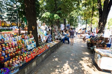 Tourists and locals looking at the stalls at Chisinau flea marke