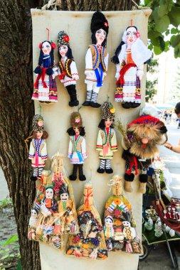 Stuffed souvenir dolls at flea market in Chisinau, Moldova. At t