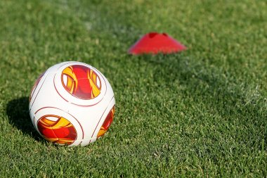 Europa League balls on the field during the training of PAOK in