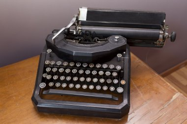 Old vintage typewriter on a rustic wooden table