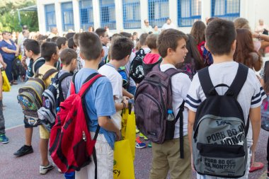 Students with their backpacks. First Day of school for the stude