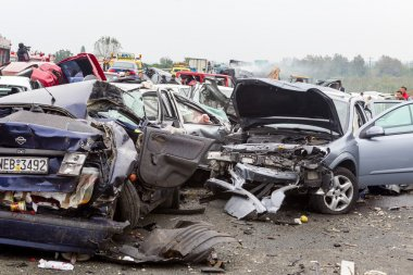 large truck crashed into a number of cars and 4 people were kil