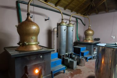 DRAMA, GREECE - NOVEBPER 15,2014: During traditional distillation of alcohol and production of homemade tsipouro, raki stock vector