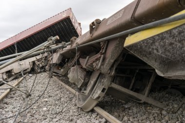Derailed train coaches at the site of a train accident at the Ge