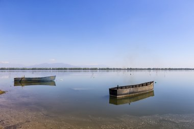 Boat at Kerkini lake in Serres, in Greece stock vector