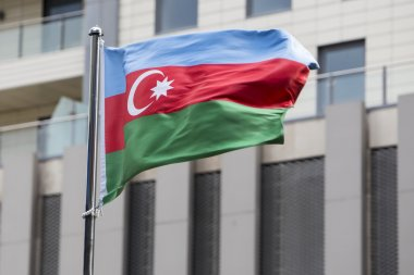Azerbaijan flag waving on the wind in front of a building