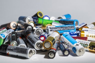 Different types of used batteries ready for recycling lying in a
