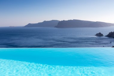 Infinity pool on the rooftop with the ocean in Santorini Island,