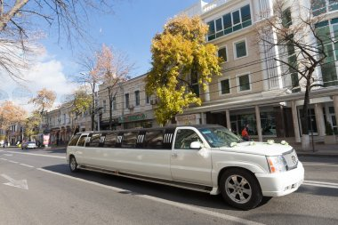 White limousine with flowers at the city street in Krasnodar, Ru