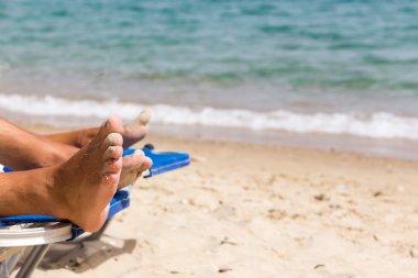 Sandy feet on the beach. Vacation Background