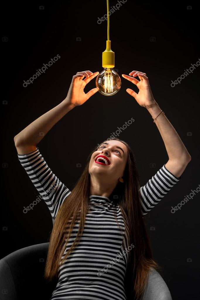 Young Female Inventor With Illuminated Lamp Stock Photo