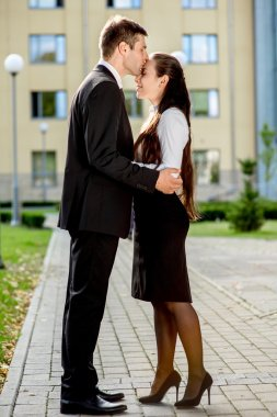 Young business couple outdoor