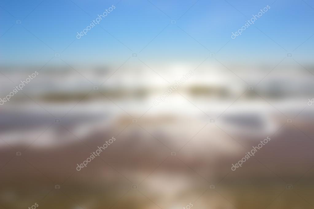 Blurred sea coast at sunrise