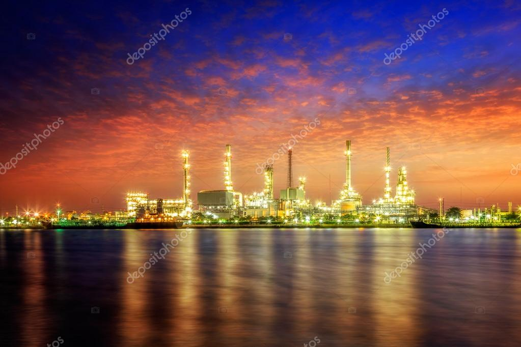 Oil refinery at twilight stock vector
