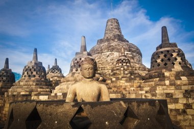 Buddha Statue at Sunset at Borobudur, Java, Indonesia