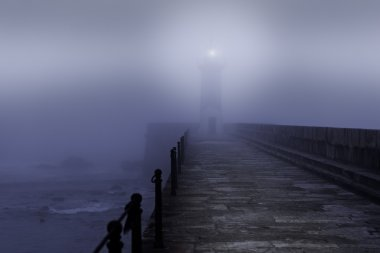 Lighthouse in a foggy night