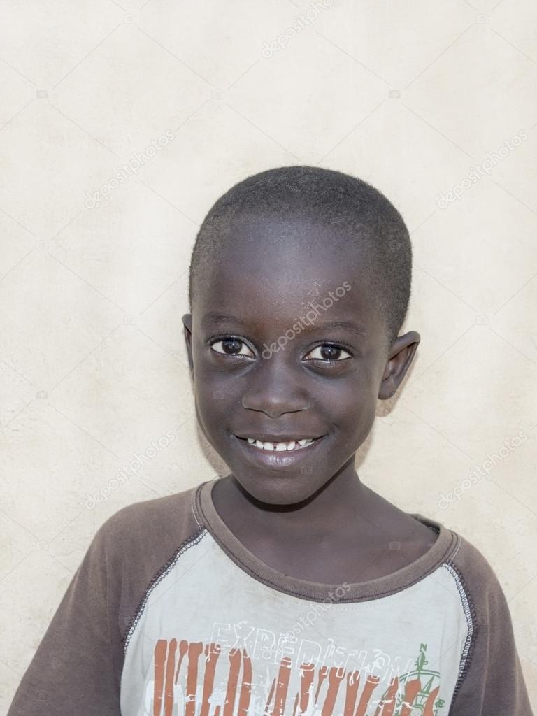 Editorial: Thiaroye, Senegal, Africa, July 23, 2014: Child in the street, popular district of Guinaw Rails