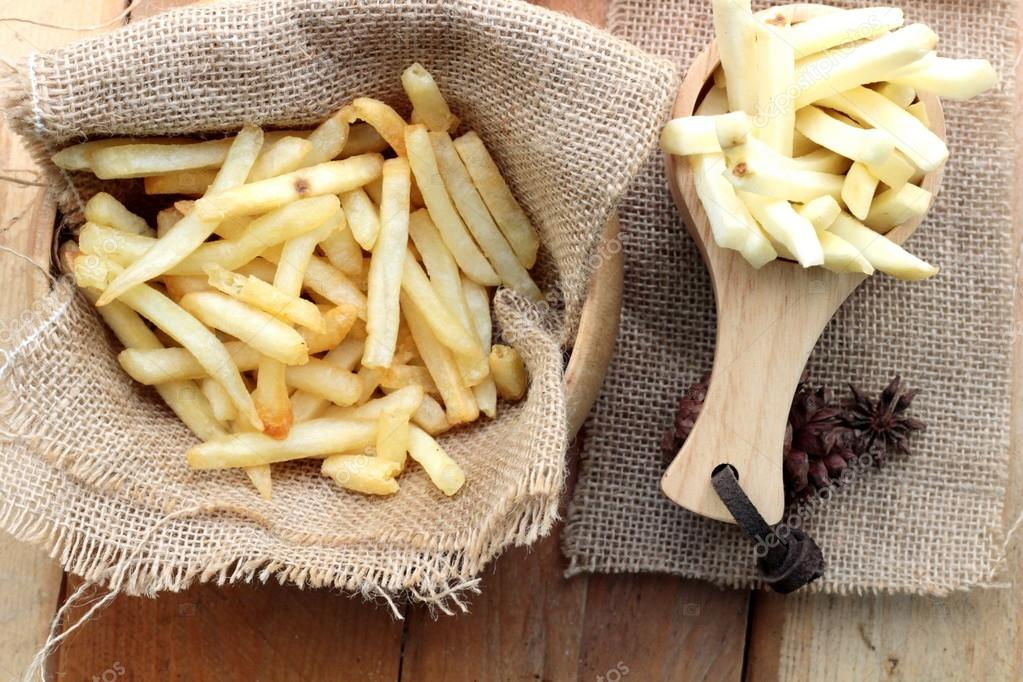 French fries and fresh potatoes sliced