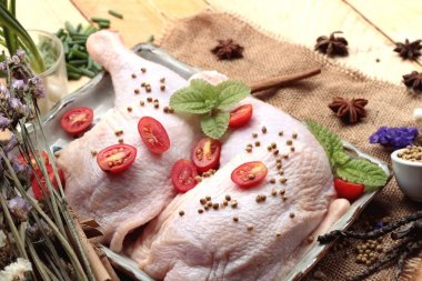 Fresh chicken and tomatoes with spices for cooking