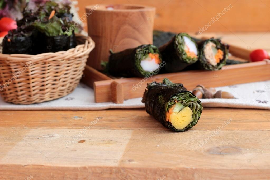Vegetable salad wrapped with seaweed into spring rolls.
