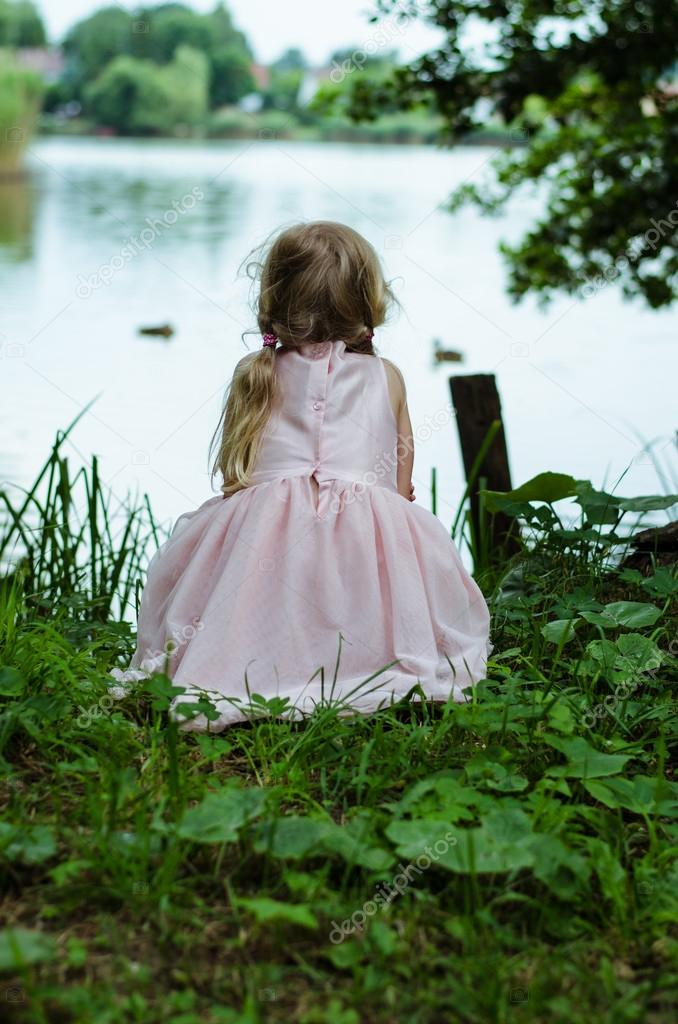 little girl by pond