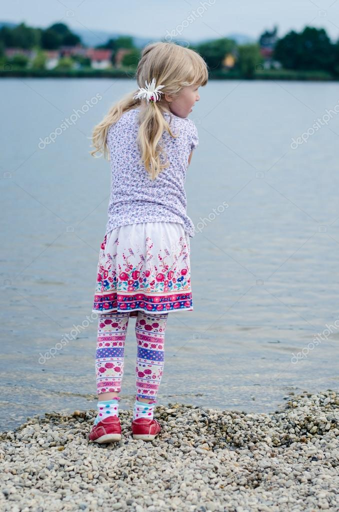 blond girl at pond