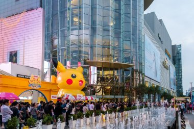Shoppers visit Siam Paragon mall and Pokemon Festiva