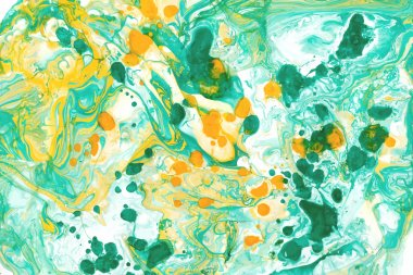 Abstract ink background. Marble style. White, green, yellow ink in water
