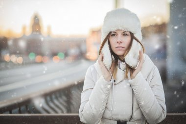 Russian woman in the winter city