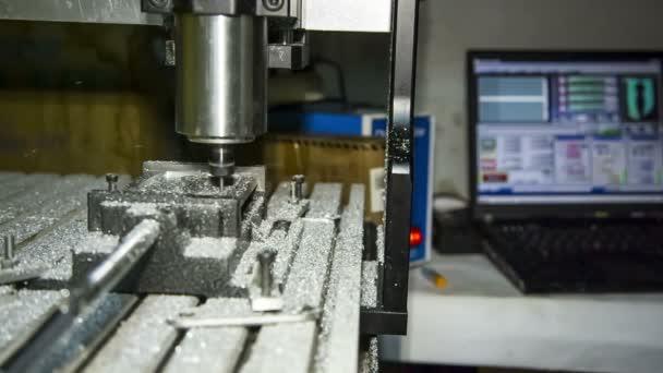 Metal lathe cutting aluminium at workshop