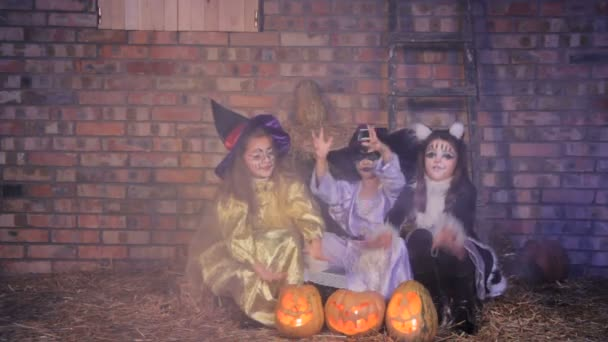 Halloween witches casting with pumpkins