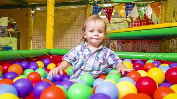 Boy is playing with multicolored balls