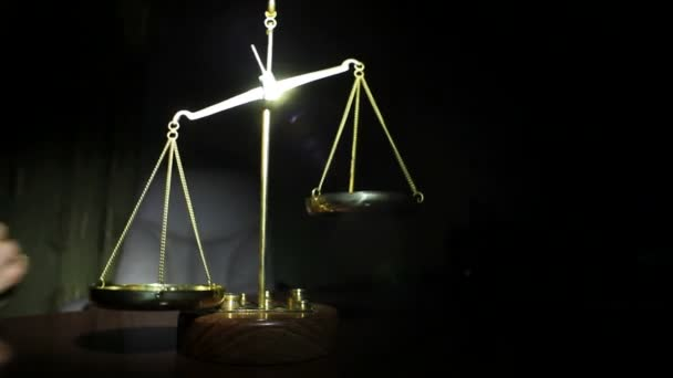 Man Putting Weight on Golden Balance Scales Standing On Table