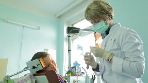 Dentist Correcting Braces For Crooked Teeth With Special Dental Instrument
