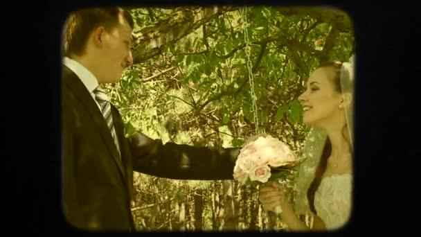 Young Groom Swinging His Beautiful Happy Bride