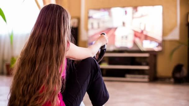 Egy lány ül a földön videójáték