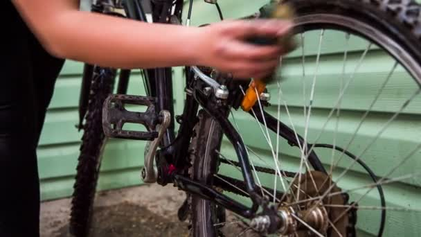 Female Cyclist Washing Bicycle Wheels