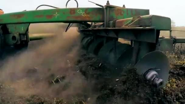 Rural Tractor Plowing Agricultural Field In Russia