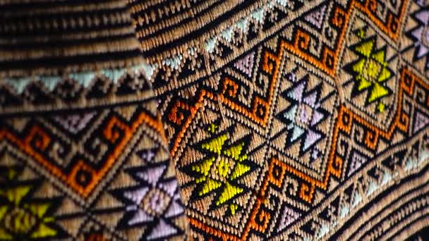4K More than 100 years old colorful thai handcraft peruvian style rug surface old vintage torn conservation Made from natural materials Chemical free close up.