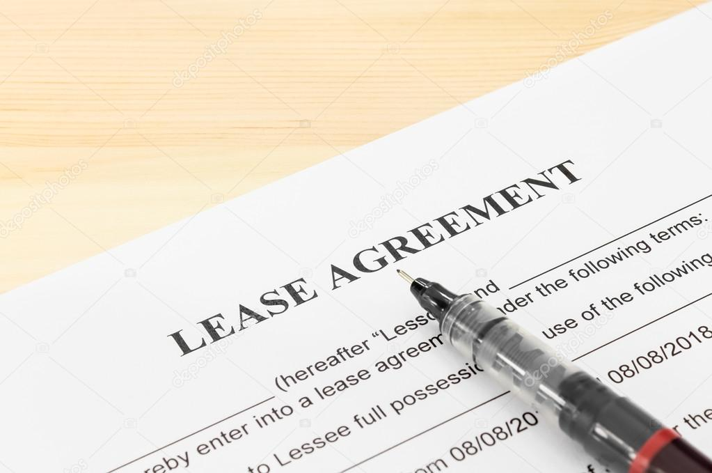 Lease Agreement Contract Document And Pen At Bottom Right Corner