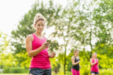 blond woman listening to music during sport