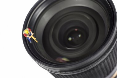 Miniature Worker On Top Of Camera Lens