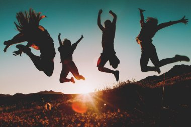 Four people jumping over the sky at sunset. Sunbeam in the background. stock vector