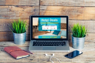 Hotel booking website template in a laptop screen.