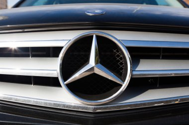 MALAGA, SPAIN - DECEMBER 2, 2015: Mercedes Benz car logo in the front of car grid.