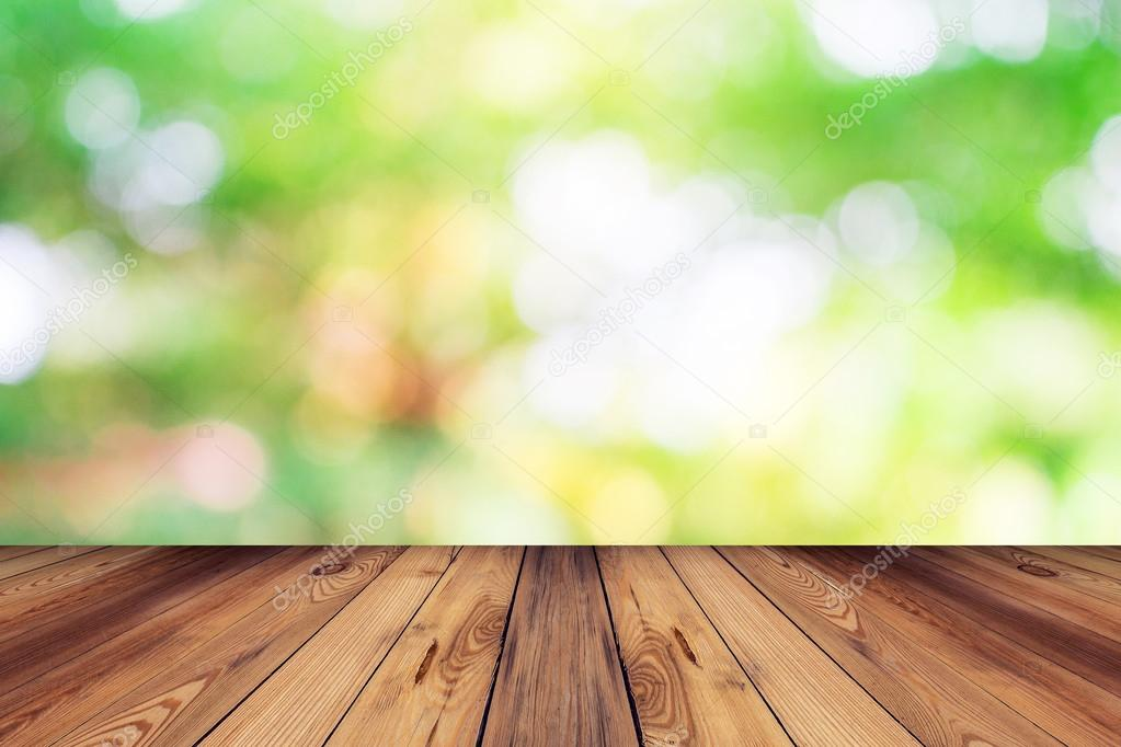 Green bokeh blur background and wood table in garden — Stock ...